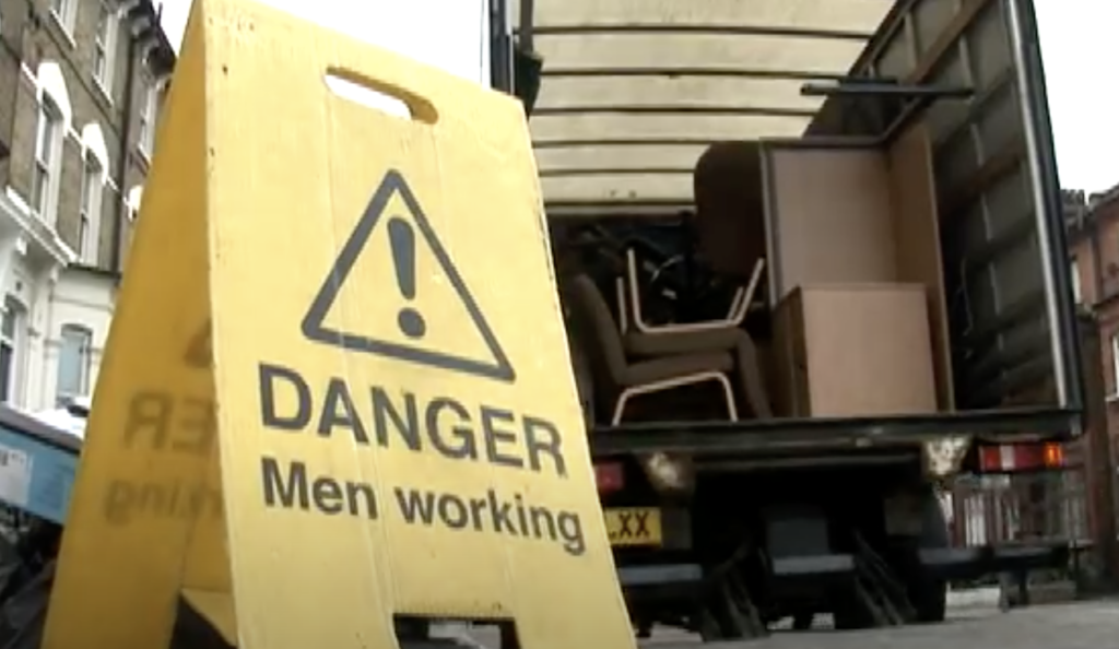 Danger sign stating Men Working for Man with Van Removals in Dundee